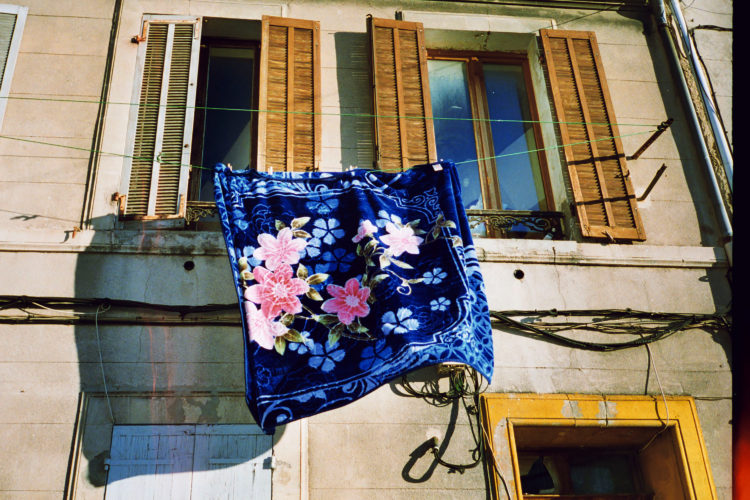 Sam Phelps   Belladone   2017-2020   A blanket hangs out a window in the 3eme arrondissement of Marseille, France, 2017.