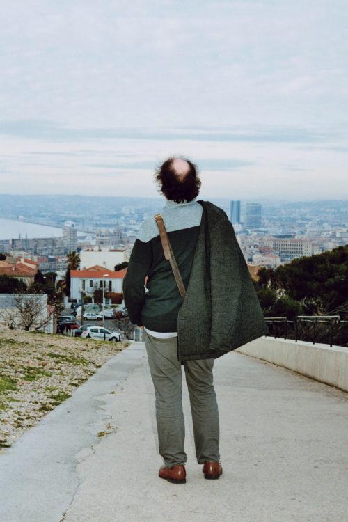 Sam Phelps   Belladone   2017-2020   A man appreciates the view of the city from Notre Dame de la Garde in Marseille, France, 2017.