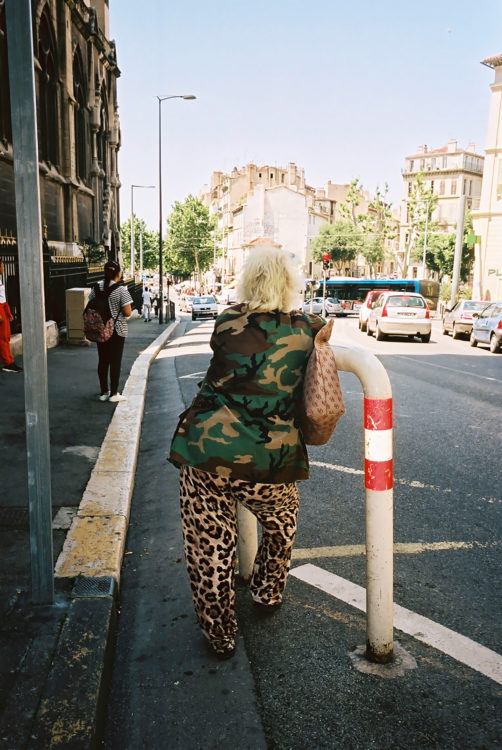 Sam Phelps   Belladone   2017-2020   A woman leans waiting for a bus at Reformes in Marseille, France ,2019.