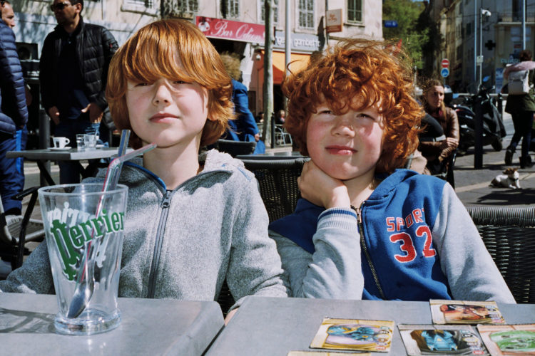 Sam Phelps   Belladone   2017-2020   Brothers sit at a cafe at Reforme in Marseille, France, 2018.