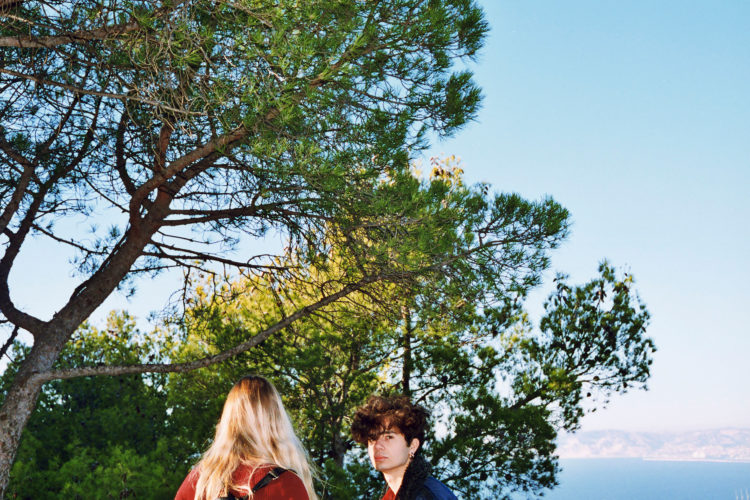 Sam Phelps   Belladone   2017-2020   A couple stand under trees at Notre Dame de la Garde in Marseille, France, 2018.